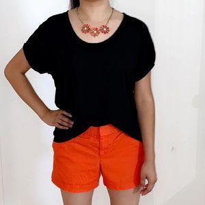 2 black shirts and 1 orange short.